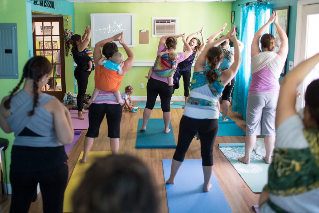 Babywearing Yoga Class for wrapped up moms and babies.