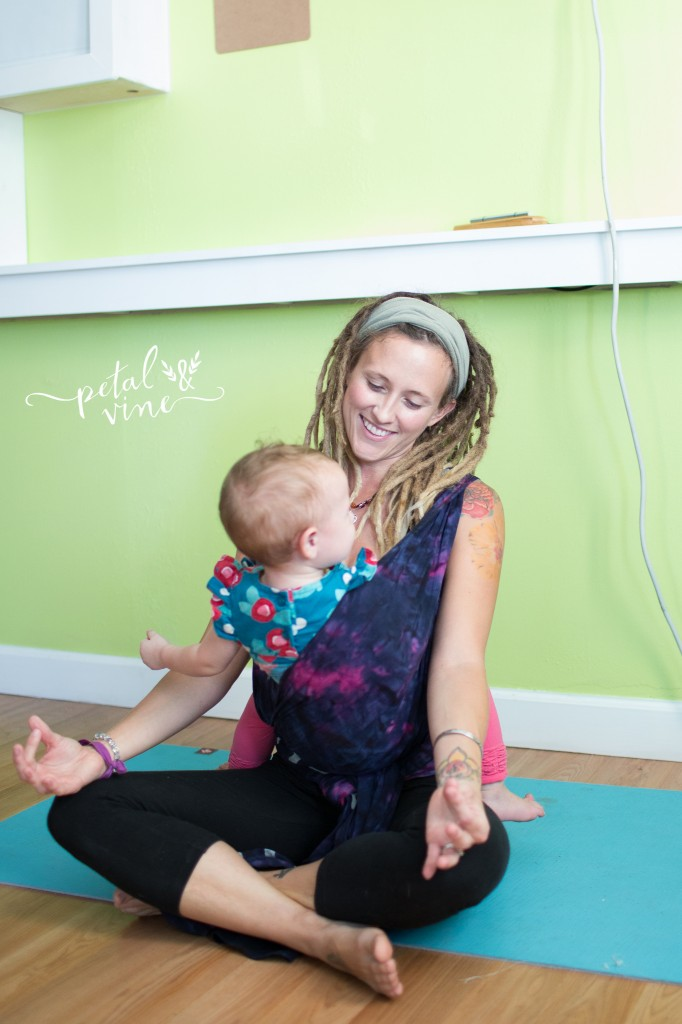 Yoga Class Teacher with toddler in Wrapsody Breeze Luna Wrap.