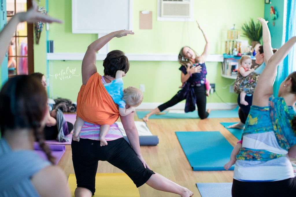 Yoga with babies and toddlers wrapped up.