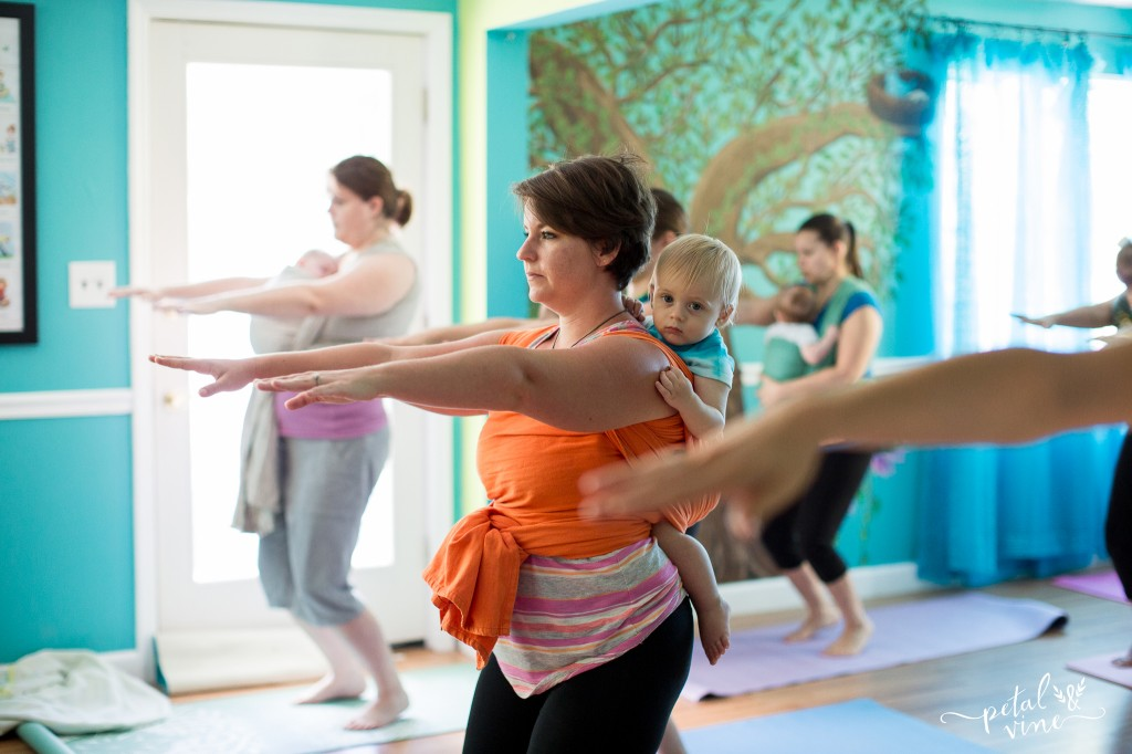 Wrapped up babies and toddlers in babywearing yoga class.
