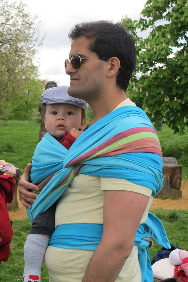 Dad wrapping baby on the Intro to Babywearing Walk