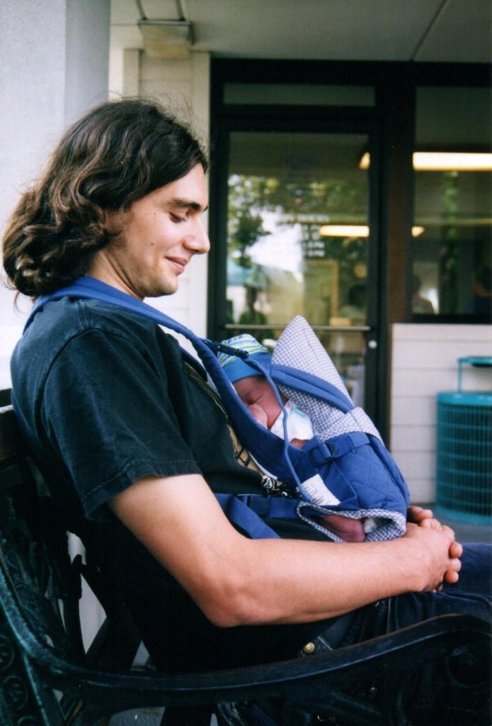 Babywearing Dad and newborn in Snugli