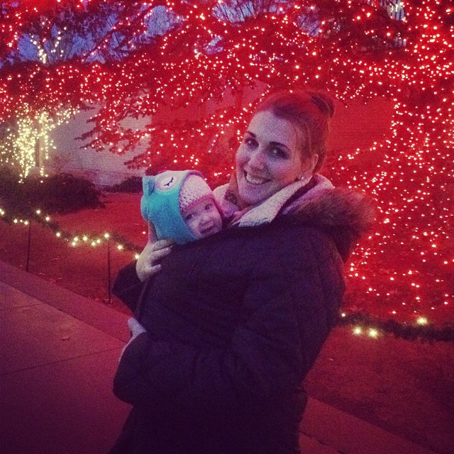 Baby wrapped at night to see Holiday LIghts